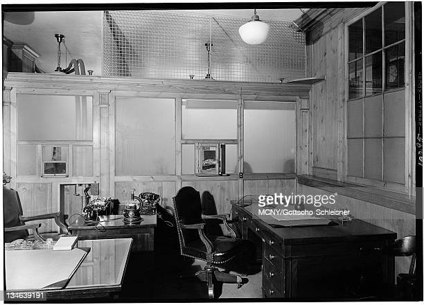 An office with three telephones and three desks Located at 51 Broadway