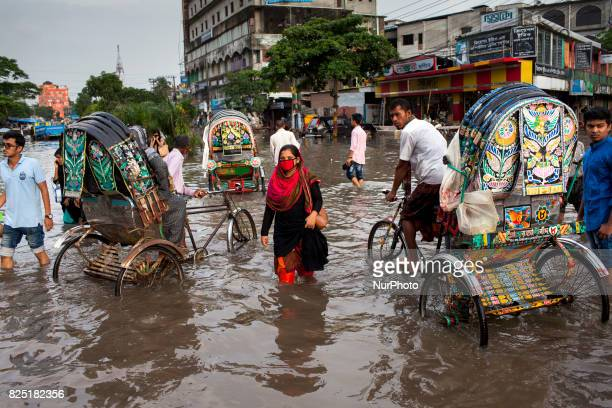 An office woman return home in water logging area July 26 2017 Chittagong Bangladesh Every day the Chittagong city is facing unmatched waterlogging...