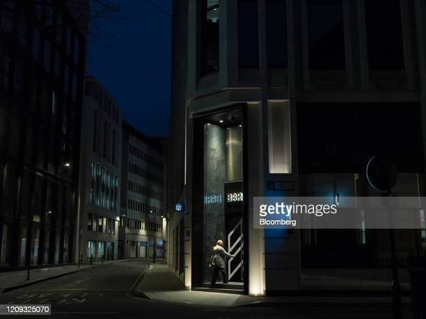 An office worker approaches a door in the early morning in the City of London UK on Monday April 6 2020 UK consumer confidence saw the sharpest...