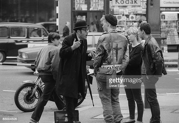 An office worker argues with protestors during a 'Stop The City' anticapitalist demonstration London September 1984