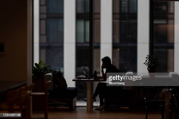 An office worker at a booth in a WeWork co-working office space in the Waterloo district in London, U.K. On Monday, Aug. 2, 2021. A survey this month...