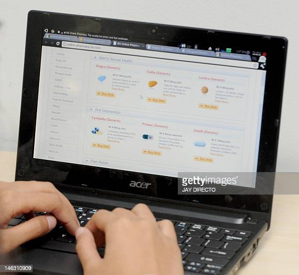 An office worker browses an online pharmacy in Manila on June 14 2012 The rapid growth of Internet commerce has led to a global 'explosion' of...