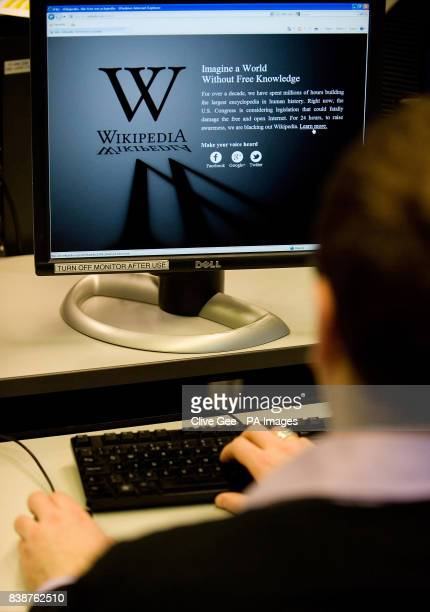 An office worker is greeted by a blacked out Wikipedia page as they attempt to access the site