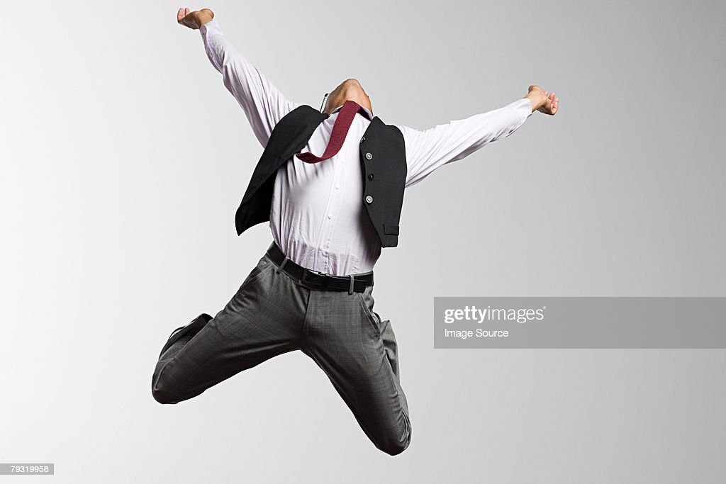 An office worker jumping : Stock Photo