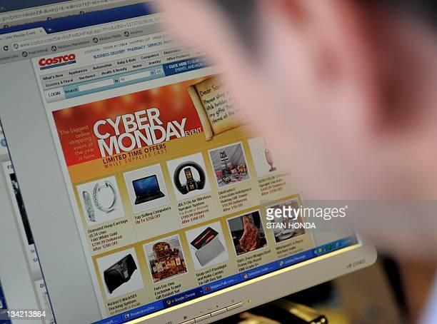 An office worker looks at Cyber Monday specials on the Costo website November 28 2011 in New York Consumers were likely to continue the Black Friday...
