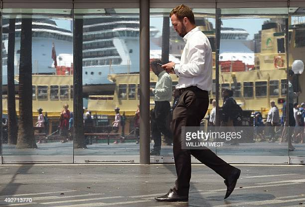 An office worker walks through Sydney's Circular Quay on October 15 as Australia's unemployment rate remained stable at 62 percent in September with...