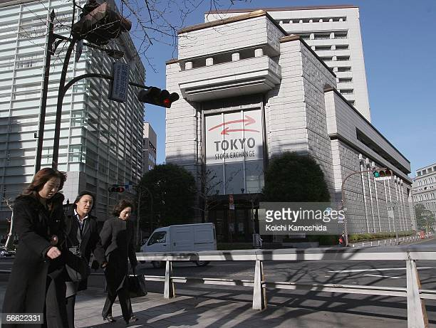 An office workers walk past the Tokyo Stock Exchange January 19 2006 in Tokyo Japan For the first time the Tokyo Stock Exchange suspended...