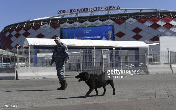 An officer and his dog patrol in front of Spartak Stadium in Moscow on June 14 a day before the match between Argentina and Iceland during the Russia...