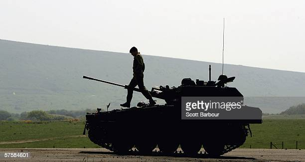 An officer checks a Scimitar tank during a media day at The Armour Centre on May 11 2006 in Dorset England Britain's Prince Harry will arrive at the...