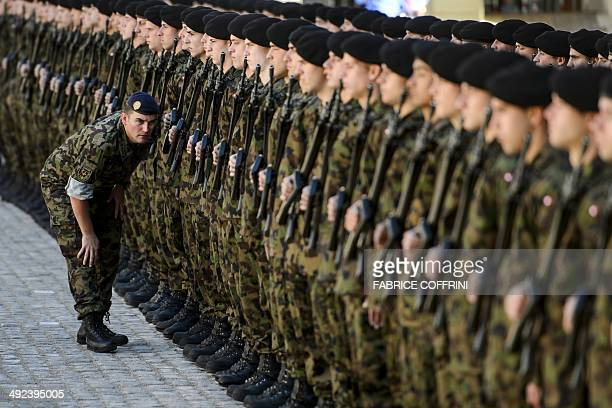 An officer checks the line of the Swiss honor guard prior to the arrival of Italian President Giorgio Napolitano on May 20 2014 in Bern Napolitano is...