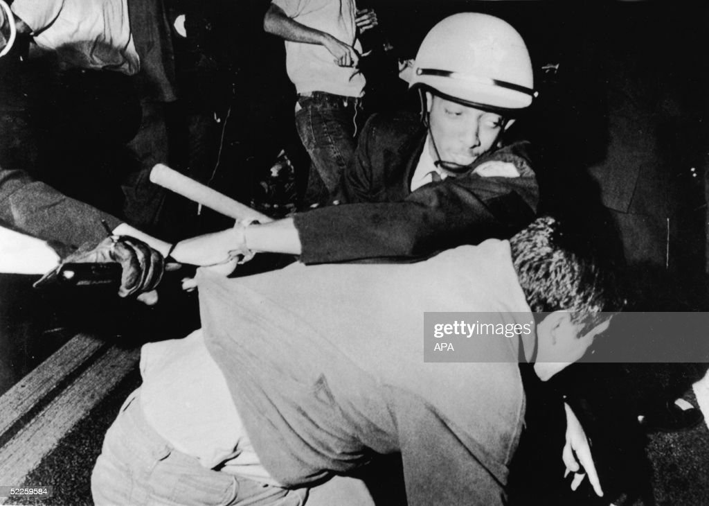 An officer from the Chicago Police Department struggles with an antiwar demonstrator outside Democratic headquarters at the Hilton Hotel on Michigan Avenue as demonstrators attempt to break through police lines to move the protest to the 1968 Democratic National Convention, being held five miles away at the International Amphitheatre, Chicago, Illinois, August 28, 1968.