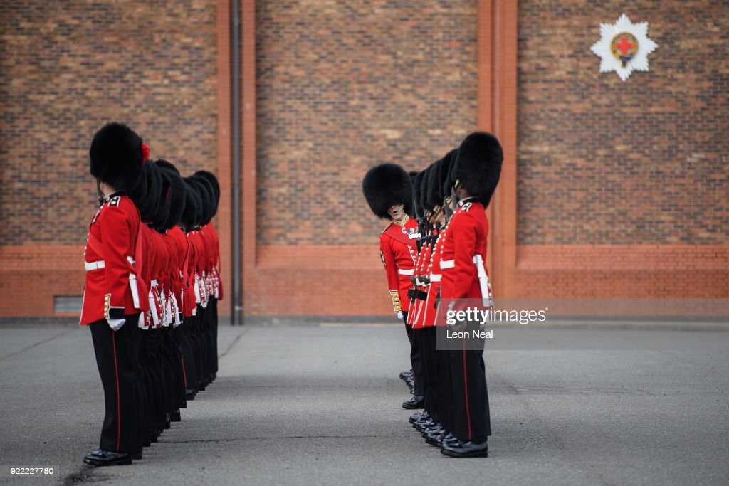 An officer from the Coldstream Guards checks the soldiers as they take part in the annual Major General's Inspection at Victoria barracks on February 21, 2018 in Windsor, England. The inspection gives the Major General his first chance to check the presentation, uniforms and drill of the battalion, ahead of it's involvement in the Trooping the Colour Parade in London.