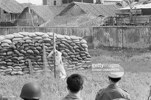 An officer from the South Vietnamese army is executed after having embezzled funds on the black market
