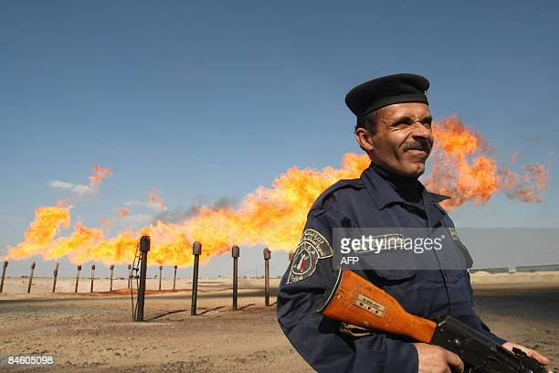 An officer guards a section of the Barjisiya oil fileds in Zubair One south west of the city of Basra 550 kms from Baghdad on February 3 2009 Plans...