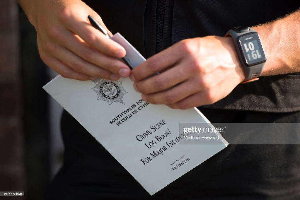 An officer holds a log book during a search of a house on Glyn Rhosyn, Pentwyn, which is believed to be the home of Darren Osborne, who has been named as the man responsible for the Finsbury Park Mosque attack, on June 19, 2017 in Pontyclun, Wales. A van ploughed into pedestrians near Finsbury Park Mosque on Severn Sisters Road, North London, at around 12.20 this morning. Police have reported that one man was killed and nine people were injured. 47-year-old Darren Osborne has been arrested on suspicion of carrying out the attack. Prime Minister Theresa May has said police are treating it as a potential terrorist incident.