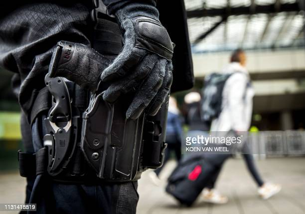 An officer keeps surveillance in a station in Rotterdam on March 18 2019 after the attack in Utrecht Three people were killed and nine injured in a...