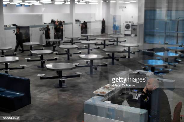 An officer keeps watch over a dormitory of the new wing of Pueblo County Detention Center on Wednesday December 6 2017 The jail which is currently...
