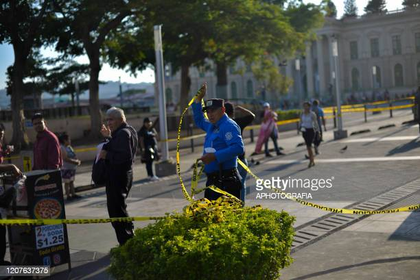 An officer of San Salvador's municipal police closes down a square on March 18 2020 in San Salvador El Salvador Despite no cases of COVID19 have been...