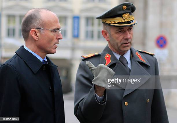 An officer of the Austrian army gestures as he talks to Austrian Minister of Defence Gerald Klug prior to the commemorations of the 75th anniversary...