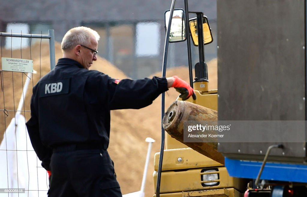 An officer of the Explosive Ordnance Disposal Division (EOD) load a five centner bomb on to a truck after it was made safe on May 7, 2017 in Hanover, Germany. Bomb disposal experts have checked five locations in the city today where unexploded bombs from World War II might possibly lie underground, two five centner and one ten centner bomb were found and dismantled. Today's evacuation is among the largest ever in post-World War II Germany. Unexploded World War II bombs, mostly from Allied aerial bombing, remain a deadly legacy and smaller scale evacuations are a regular occurrence in major urban centers across Germany throughout the year.