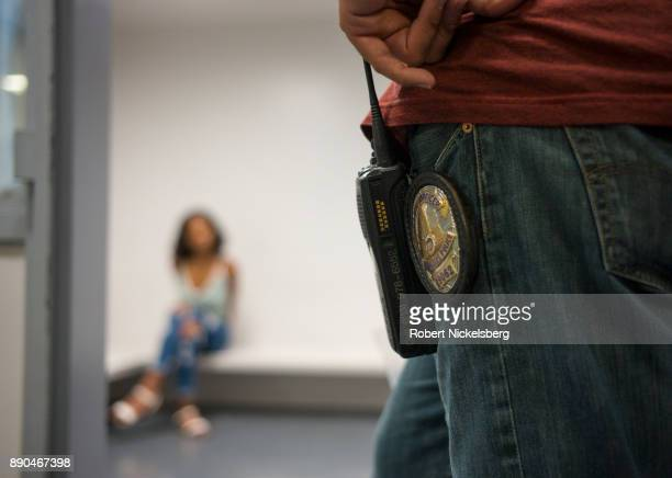 An officer of the Los Angeles Police Department's vice squad right monitors a 17year old woman before she's transported to a state agency for minors...