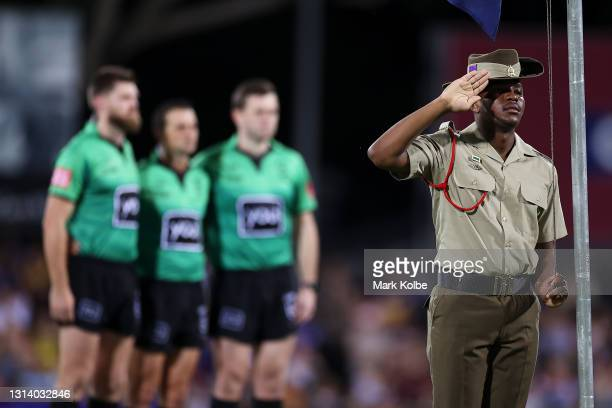 An officer salutes during an ANZAC ceremony before the round seven NRL match between the Parramatta Eels and the Brisbane Broncos at TIO Stadium, on...
