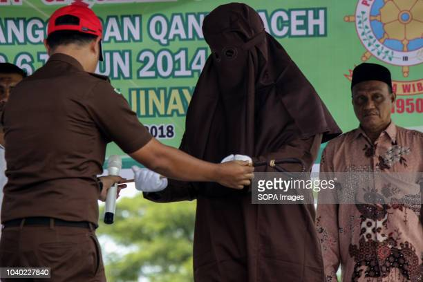 LHOKSEUMAWE ACEH INDONESIA An officer seen receiving a whip for flogging all the convicted people for violating the Islamic Sharia law Although...