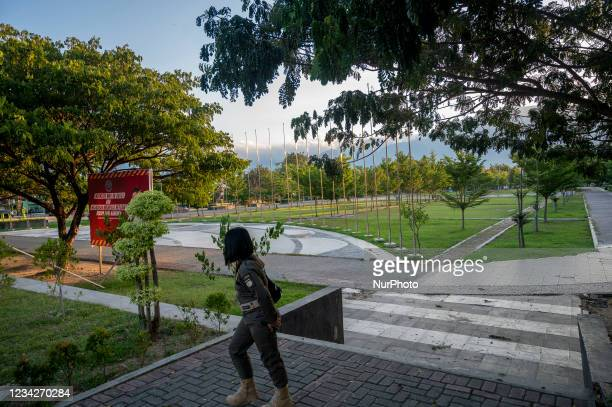 An officer stands guard at a public facility at Vatulemo Field, Palu City, Central Sulawesi Province, Indonesia on July 28, 2021. To reduce the...