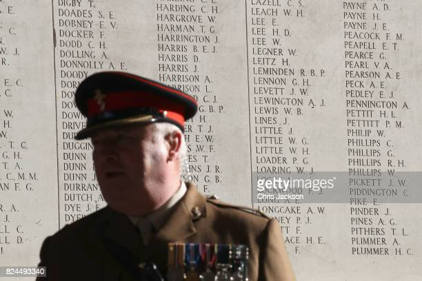 An officer stands in front of the names of 50,000 lost soldiers which are engraved inside the Menin Gate at the Commonwealth War Graves Commission...