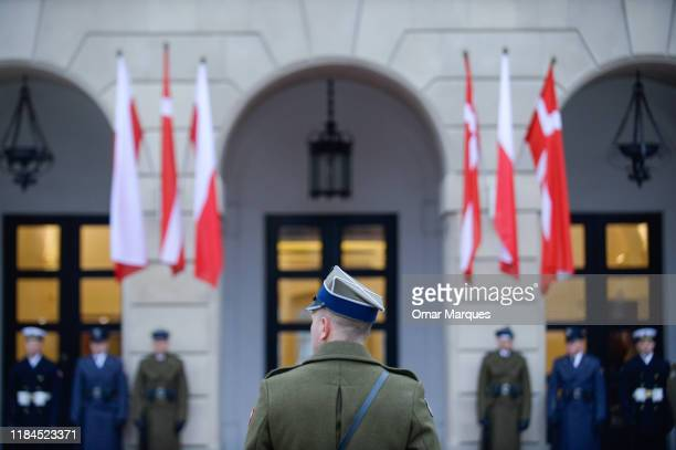 An officer stands in front of the Presidential Palace during the official welcome ceremony for the Danish Crown Prince Couple Visit Poland on...