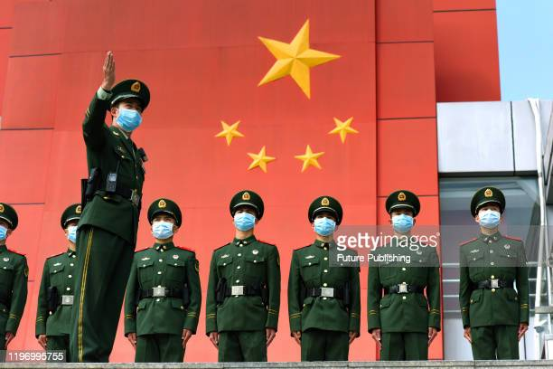 An officer talks to the paramilitary policemen before their duty shift in an area bordering Hong Kong in Shenzhen in south China's Guangdong province...