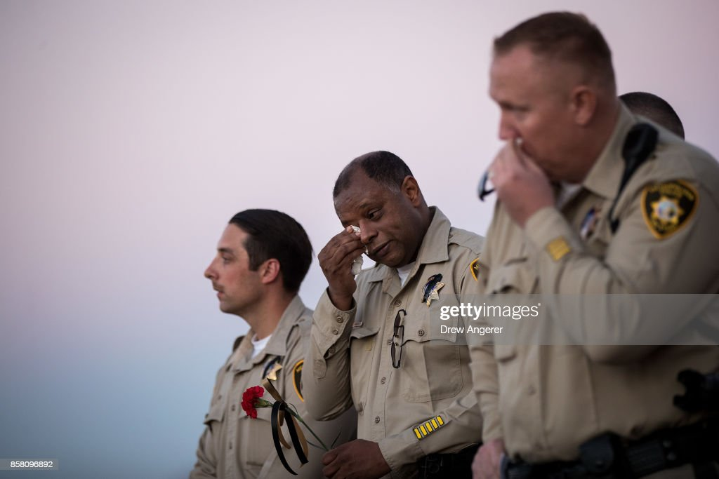 An officer wipes away tears during a vigil for Las Vegas Metropolitan Police Department Officer Charleston Hartfield at Police Memorial Park on October 5, 2017 in Las Vegas, Nevada. Hartfield, who was off duty at the Route 91 Harvest country music festival on October 1, was killed when Stephen Paddock opened fire on the crowd killing at least 58 people and injuring more than 450. The massacre is one of the deadliest mass shooting events in U.S. history.