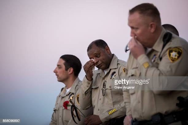 An officer wipes away tears during a vigil for Las Vegas Metropolitan Police Department Officer Charleston Hartfield at Police Memorial Park on...