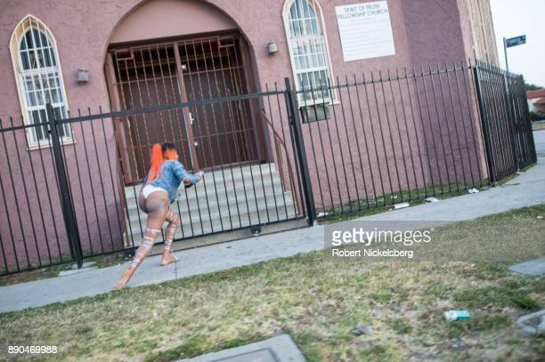 An officer with the Los Angeles Police Department's vice squad follows a woman running away from being arrested May 18 2017 in the southeast area of...