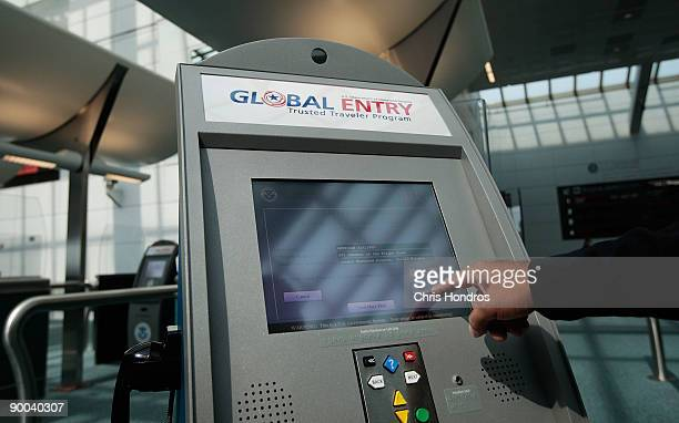 An officer with the US Customs and Border Protection demonstrates a new arrivals processing kiosk at Newark International Airport August 24 2009 in...