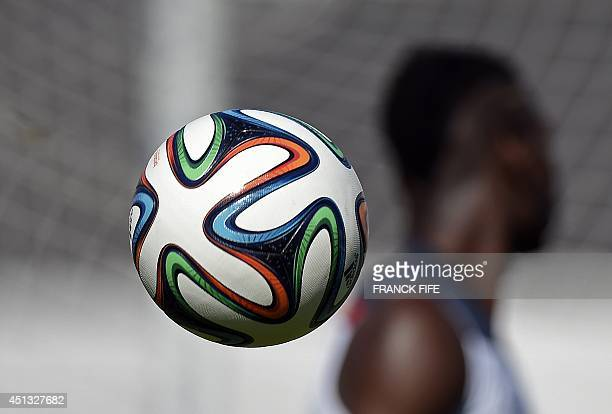 An official 2014 FIFA World Cup ball Brazuca is seen during a training session of France at the stadium Santa Cruz in Ribeirao Preto on June during...