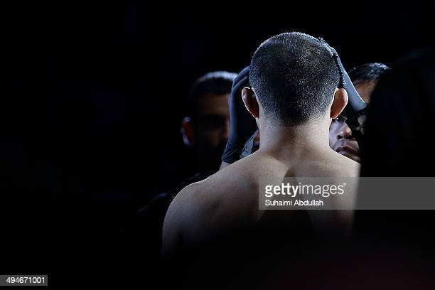 An official applies vaseline on Bakhtiyar Abbasov of Azerbaijan face before his fight against Ben Askren of United States of America during OneFC...