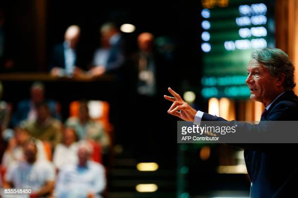 An Official auctioneer gestures on August 19 2017 during the Yearlings sales one of the world renowned annual thoroughbred sales in Deauville This...