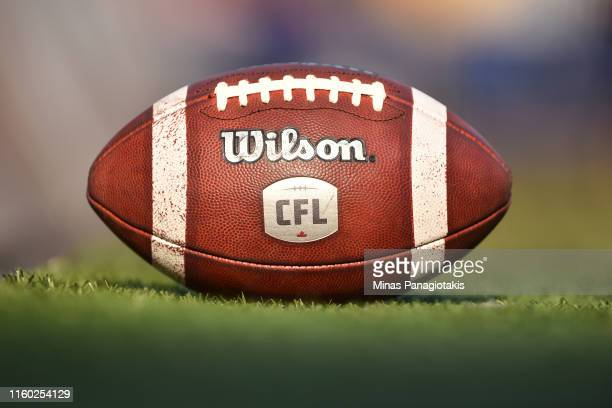 An official ball sits on the field prior to the CFL game between the Montreal Alouettes and the Hamilton Tiger-Cats at Percival Molson Stadium on...