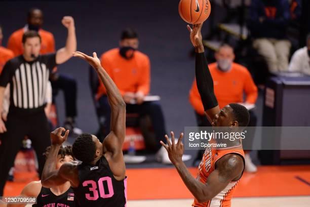 An official calls a foul as Illinois Fighting Illini center Kofi Cockburn shoots the ball over Penn State Nittany Lions forward Abdou Tsimbila during...