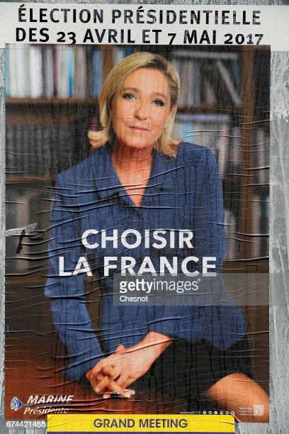 An official campaign poster of Marine Le Pen, French National Front political party leader is displayed on April 27, 2017 in Paris, France. Le Pen...
