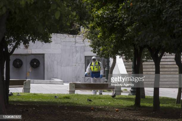 An official carries out disinfection work at Sintagma Square as part of precautions against the coronavirus in Athens, Greece on March 24, 2020.