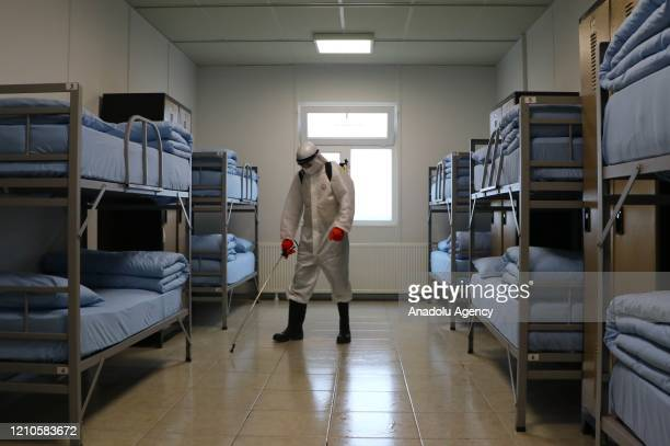 An official carries out disinfection works at sleeping quarters within precautions against coronavirus pandemic at 66th Mechanised Infantry Brigade...