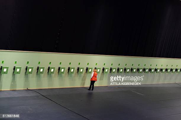 An official checks the controlband of targets in AUDI Arena of Gyor on February 26 2016 prior to the qualification round of 10m air rifle category...