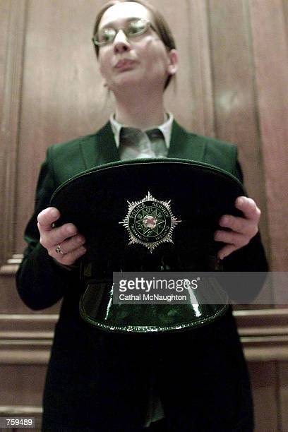 An official displays the new logo adopted by the PSNI formerly the Royal Ulster Constabulary march 27 2002 in Belfast The uniform and emblem were...