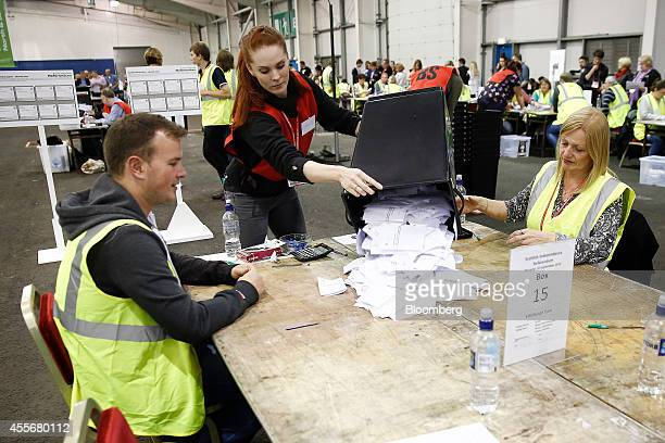 An official empties a ballot box containing Scottish independence referendum votes at the Royal Highland Center in Edinburgh UK on Thursday Sept 18...