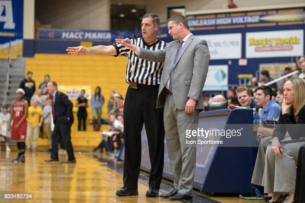 An official explains a call to Kent State Golden Flashes head coach Todd Starkey during the first half of the Women's college basketball game between...