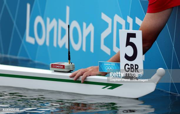 An official fits a GPS tracker to the boat of Great Britain's Alan Campbell in the heats of the Men's Single Sculls during a heat at Eton Dorney...