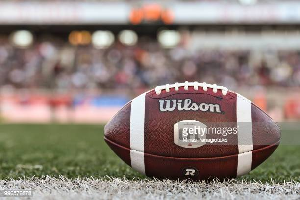 An official football sits on the field during the CFL game between the Montreal Alouettes and the Ottawa Redblacks at Percival Molson Stadium on July...