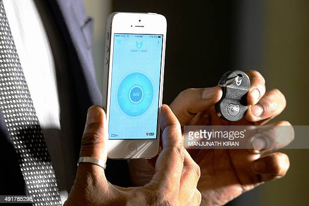 An official for BMS Innolabs which developed 'AVA' a personal safety enabler device and its mobile app poses for a photograph during the launch in...